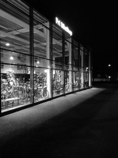Illuminated Night Shop Bicycles Blackandwhite