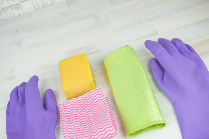 Cleaning Cleaning Equipment Cleaning Rag Close-up Day High Angle View Housecleaning Housework Human Body Part Human Hand Hygiene Indoors  Multi Colored Occupation One Person People Protective Glove Purple Sanitary Sponge Spring Cleaning Stuff Washing Up Glove Wooden Background Working