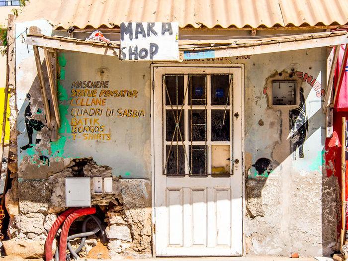 Abandoned shop in Santa Maria, Sal Island, Cabo Verde Shop Entrance Sign Abandoned Building Exterior