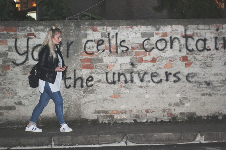 your cells contain the universe. woman walking near a wall with graffiti City Full Length Beauty Females Youth Culture Women Teenager Communication Artist Beautiful Woman Street Art Hip Hop Aerosol Can Bling Bling Canister Graffiti Pink Hair Spray Bottle Rap Vandalism Scribble Ghetto One Teenage Girl Only Breakdancing City Street Mural Spray Paint