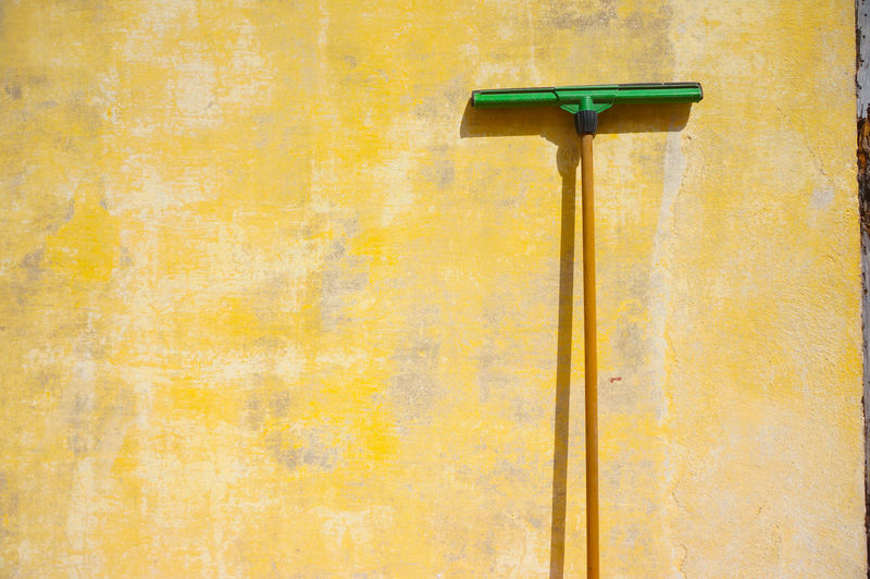 Ready to serve ⛲☸️ Standing Squeegy Squilgee Cleaning Essentials Cleaning Tools Home Depot Rubber House Cleaning House Cleaning Services Cleanup Cleaning Materials Housekeeping Yellow Backgrounds Textured  Architecture Wall Built Structure MnM MnMl Mnmlsm Minimalism Minimal Minimalistic Minimalmood