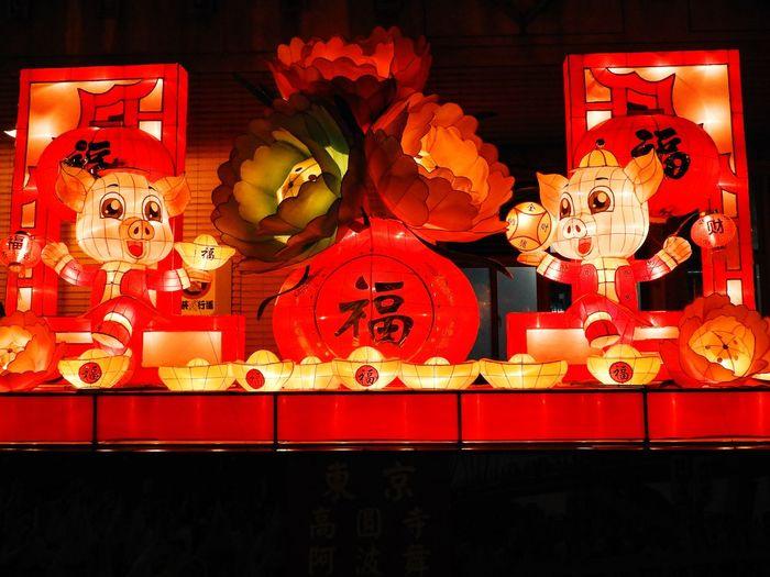 Illuminated lanterns on wall at night
