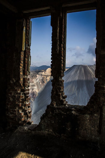 Scenic view of landscape seen through window