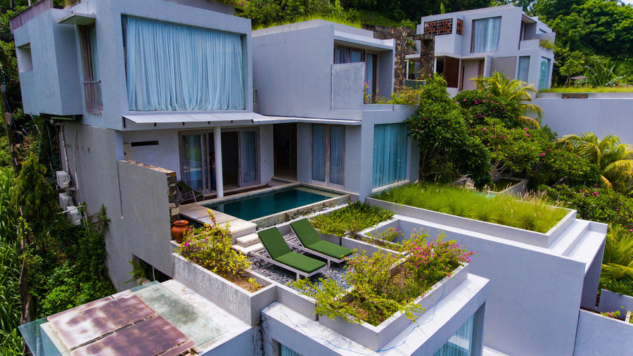 looks resort Svarga is located on the island of Lombok. Plant Architecture Built Structure Building Exterior Nature Day No People Building Front Or Back Yard Pool Swimming Pool Tree Outdoors Water Grass Absence House Growth High Angle View Luxury Svarga Hotel Hotel View Resort Resort Hotel