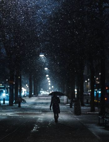 A night thought ... Fujifilm_xseries Fujifilm Bokeh Streetphotography EyeEm Best Shots Night Weather Rain Rear View Street Full Length Winter Walking Illuminated One Person Snowing Snow Outdoors Road The Way Forward Cold Temperature Street Light Tree Wet City Stories From The City