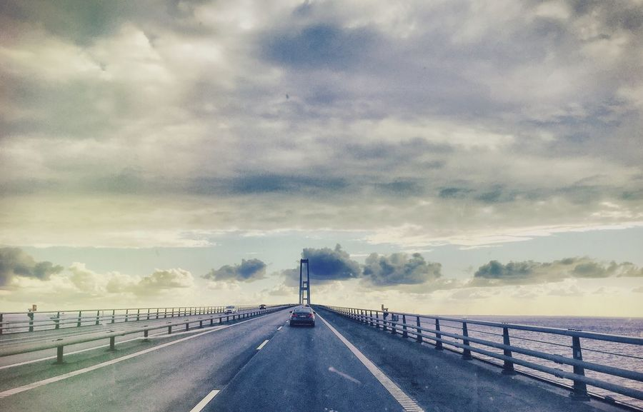 Drivin the øresund Bridge which leads two countries Together across the Ocean with a Beautiful Sky ❤️