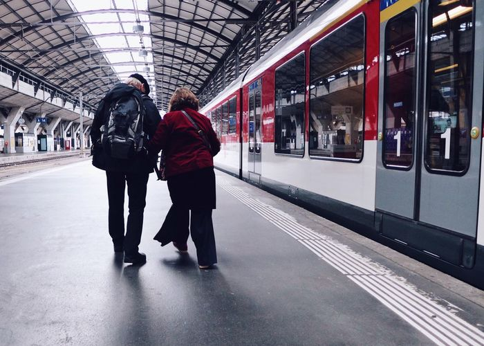 Traveling Home For The Holidays Switzerland Transportation Travel Train - Vehicle Public Transportation Red Commuter Adults Only Subway Train Modern Waiting Indoors  Standing Adult People Men Passenger Women Full Length Rush Hour Mytrainmoments Mydtrainmoments מיישוויץ The Street Photographer - 2017 EyeEm Awards