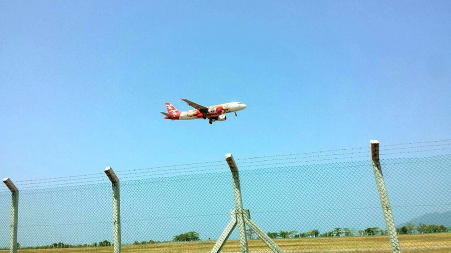 Air Asia Air Vehicle Airplane Clear Sky Day Flying Low Angle View Mid-air Motion Nature Outdoors Sky Stunt Transportation