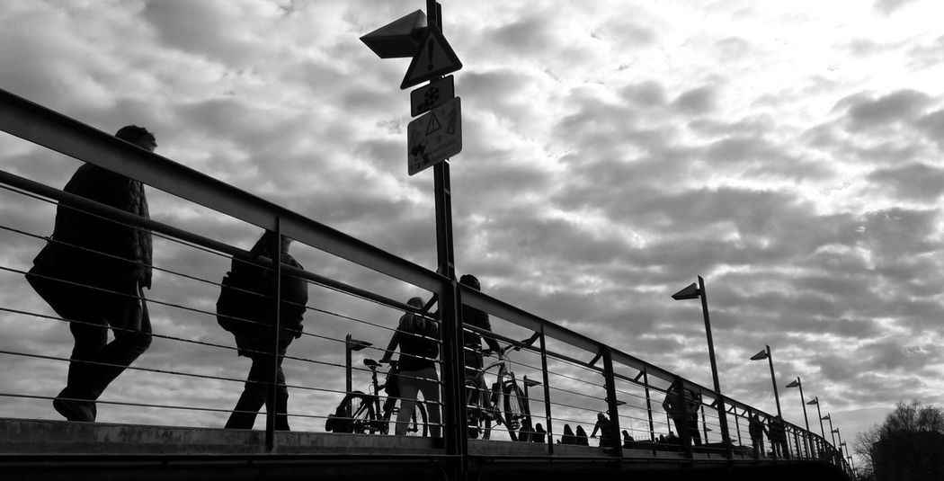 Bridge 1 Streetphotography Urban Photography Bridge Bridge - Man Made Structure Cloud - Sky Metal Full Frame Urban Scenes Outdoor People Silhouettes Bicycles Lake Constance The Street Photographer - 2017 EyeEm Awards