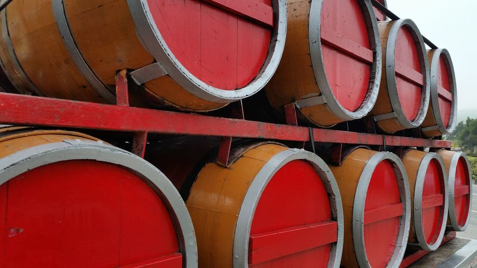 Abundance Architecture Barriques Building Exterior Built Structure Casks Close-up Day EyeEm EyeEm Gallery High Angle View In A Row Metal Mode Of Transport No People Old Order Outdoors Part Of Red Rusty Side By Side Transportation Wine Wood - Material