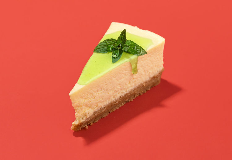 Close-up of cake against red background
