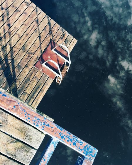 High angle view of ladder on pier at lake
