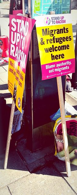 Resist Racism Refugees Politics And Government Political Protest Protest Signs Protest Posters Brighton England, UK Outdoors Day Sunshine Sunny Iconic Posters Competition Followme Sign Up Table Streetphotography Photography Taken On My Phone Taken On Mobile Device Huaweiphotography HuaweiP9