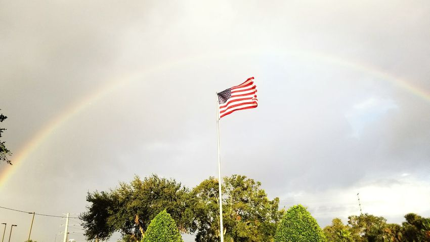 USA Flag Rainbow No People Sky Outdoors Patriotism USA USA FLAG United States United States Of America USA Beauty In Nature USAflag Flag In The Wind Flag In The Sky Rainbow Flag Rainbow Sky