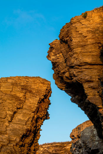 Beauty In Nature Blue Brown Cathedrals Beach Cliffs Day Eroded Erosion Galicia, Spain Geology Low Angle View Natural Pattern Nature No People Non-urban Scene Outdoors Perspective Physical Geography Rock Rock - Object Rock Formation Scenics Sky Tranquil Scene TakeoverContrast