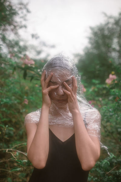 devil may care Portrait Of A Woman Portraits Portrait Photography Faces Of EyeEm Close Up Eyes Closed  Girl Hands Over Face Hands Hand Garden Young Women Beauty Human Hand Beautiful Woman Women Portrait Human Face Females Inner Power End Plastic Pollution