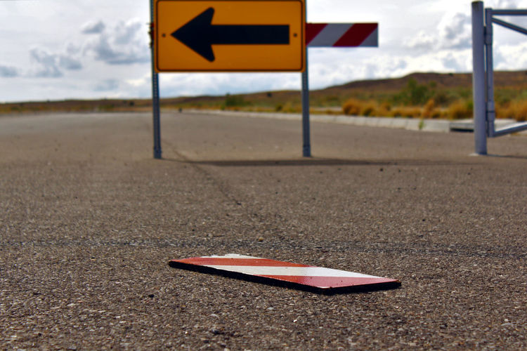 Broken barrier. Barrier Broken Busted Focus On Foreground Ignoring The Signs No People Parts Pieces Road Road Sign Signage Signs Snapped Striped Pattern Vandalism Warning Sign Yellow