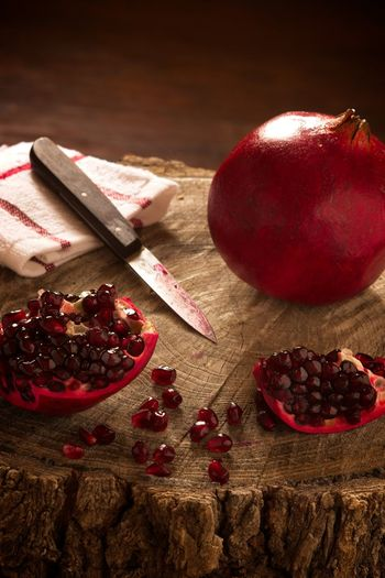 Pomegranate: Room for Copy Natural Light Food Freshness Fruit Healthy Eating Kitchen Knife No People Pomegranate Pomegranate Seed Red Room For Copy Room For Text Rustic Still Life Sweet Food Tree Stump Wood - Material