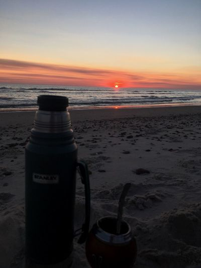 Summer Memories 🌄 Summertime Summer Uruguay♥♥ Uruguayan Culture Uruguay Stanley Mate Beach Sky Land Sunset Sea Sand Water Orange Color Scenics - Nature Beauty In Nature Nature Horizon Over Water Tranquil Scene Horizon No People Tranquility Bottle Outdoors Container