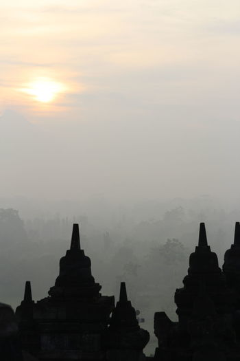 Silhouette Borobudur Temple with the mysteries forest surrounding during sunrise, Yogyakarta, Indonesia Ancient Borobudur Temple Java Yogyakarta Ancient Ancient Civilization Architecture Belief Buddhism Built Structure Dawn Fog Forest History Mount Merapi No People Outdoors Place Of Worship Religion Religious Architecture Sky Spirituality Sunrise Sunset The Past