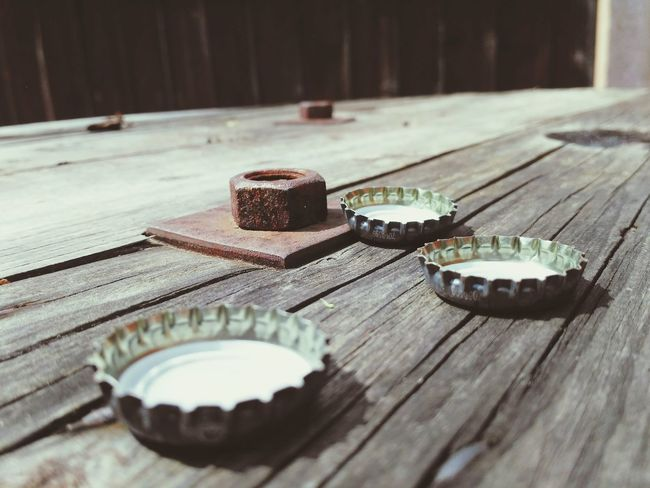 Party! Table Top Social Gathering Bottle Tops Bottle Top Bottle Cap Beer Cap Party vanishing point Drinking Beer Coke Summer Summertime Wood - Material Table Close-up Modern Hospitality