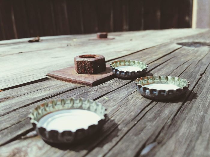 Party! Table Top Social Gathering Bottle Tops Bottle Top Bottle Cap Beer Cap Party vanishing point Drinking Beer Coke Summer Summertime Wood - Material Table Close-up
