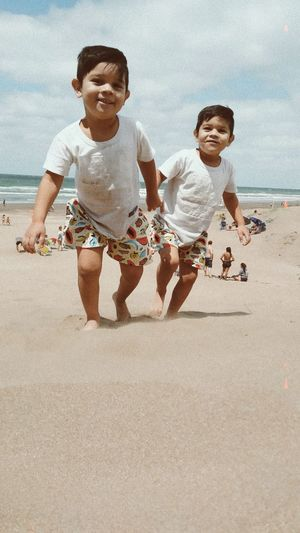 My beautiful twin children playing on the shores of my beautiful argentina