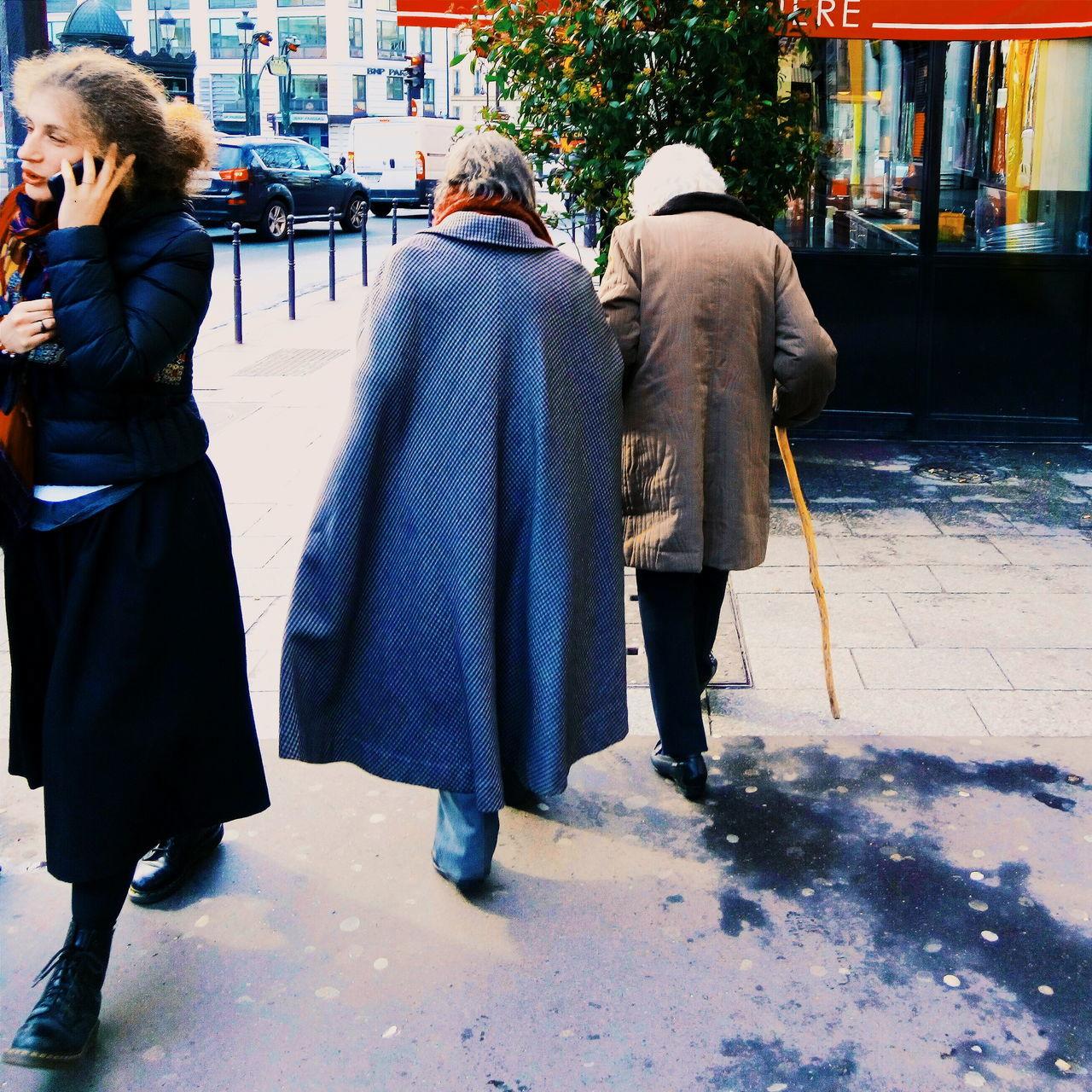 VIEW OF PEOPLE WALKING ON FOOTPATH