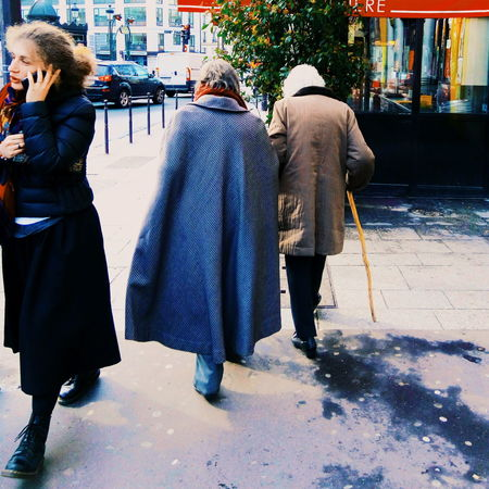 Showcase March Silhouettes Of A City Sidewalk Aging In Style Fashion Cape  On The Phone... Streetphotography Paris, France  Parisian Chic Clichy Cane Sunny Day Winter Up Close Street Photography The Street Photographer - 2016 EyeEm Awards The Following Girl Power
