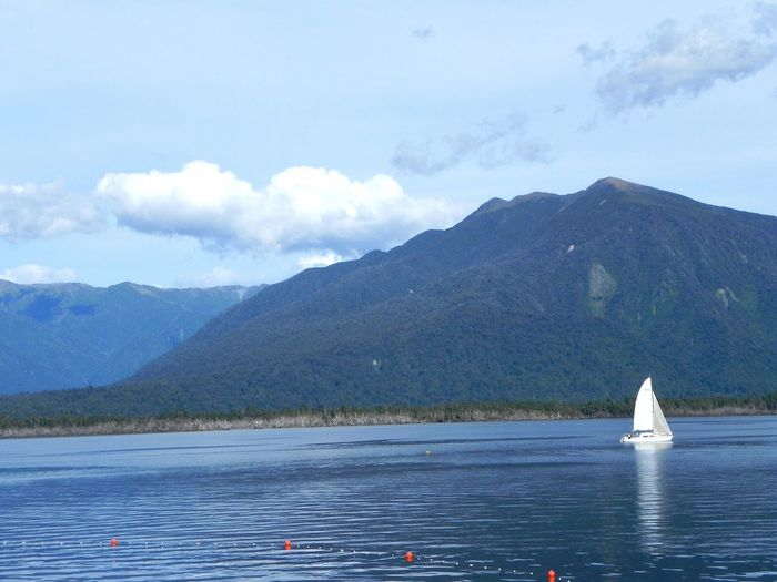 Sailboat on Lake Brunner - New Zealand Sky Mountain Sailboat Water Transportation Sea Scenics Mode Of Transport Nautical Vessel Outdoors Cloud - Sky Waterfront Beauty In Nature Nature Mountain Range Sailing No People Tranquility Day An Eye For Travel