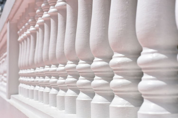 White concrete temple balcony fence in bright sunlight Sunlight Background Pattern Backgrounds Balcony Balcony Fence Buddhist Temple Close-up Concrete Concrete Balcony Concrete Structure Fence Fence Shadow In A Row No People Temple Fence