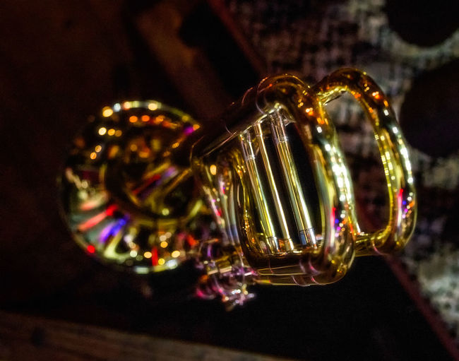 Trumbone under Stage Lights Trumbone Bracelet Close-up Creativity Decoration Design Fashion Focus On Foreground Glass - Material Gold Colored Illuminated Indoors  Jewelry Luxury Metal Musical Instrument No People Pattern Selective Focus Shiny Still Life Table Transparent