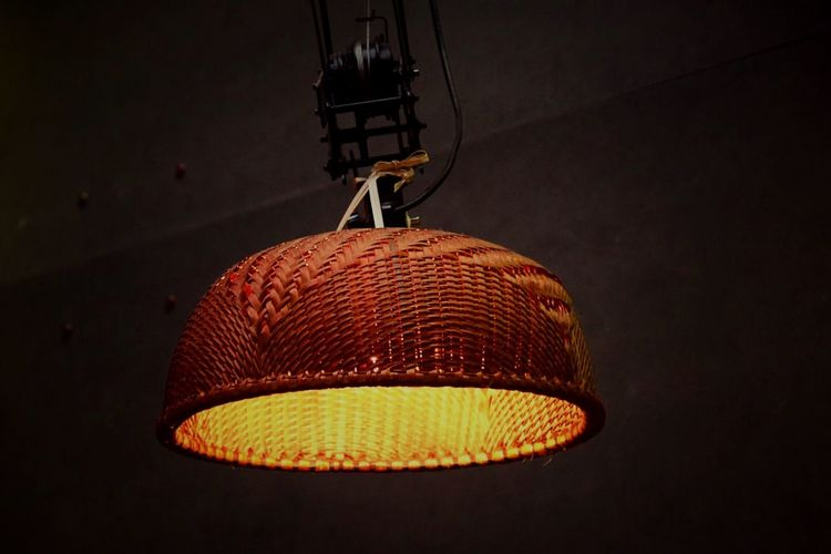 Low Angle View Of Illuminated Wicker Lamp Hanging On Ceiling