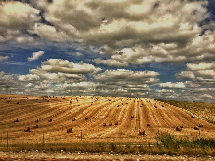 Traveling Train Cloud - Sky Sky Field Agriculture Beauty In Nature Landscape Tranquility Rural Scene Nature Tranquil Scene Day Scenics No People Outdoors Hay Bale