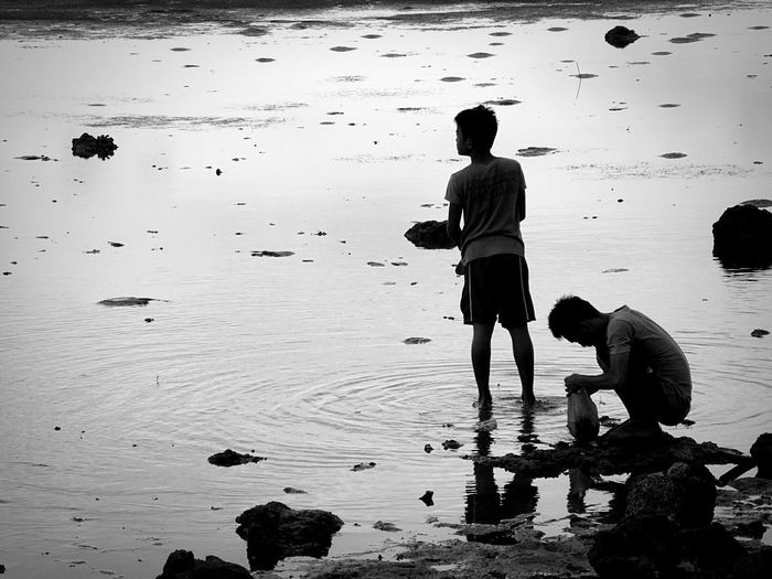 Brothers spending leisure time at seashore
