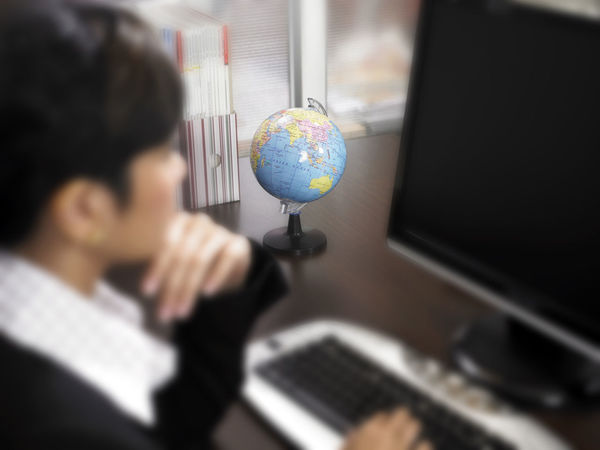 Business Stories Office Suit Adult Businesswoman Close-up Computer Day Focus On The Background Formalwear Headshot Indoors  Lifestyles One Person People Planet Earth Real People Selective Focus Technology