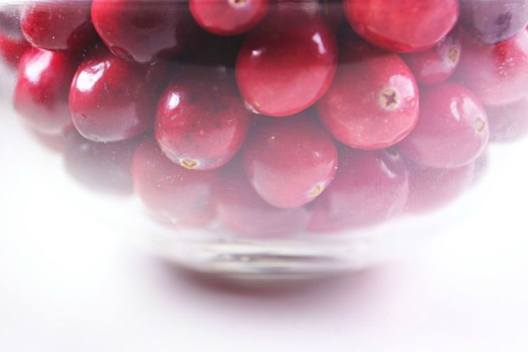 Close-up of cranberries in glass bowl