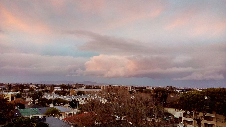 City Sunset Urban Skyline Storm Cloud Multi Colored Dramatic Sky Sky Architecture Residential District Overcast Atmospheric Mood