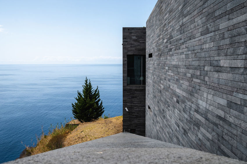 Water Sea Sky Architecture No People Day Nature Built Structure Beach Building Exterior Horizon Over Water Horizon Land Outdoors Scenics - Nature Tranquility Tranquil Scene Beauty In Nature Wall Concrete Luxury