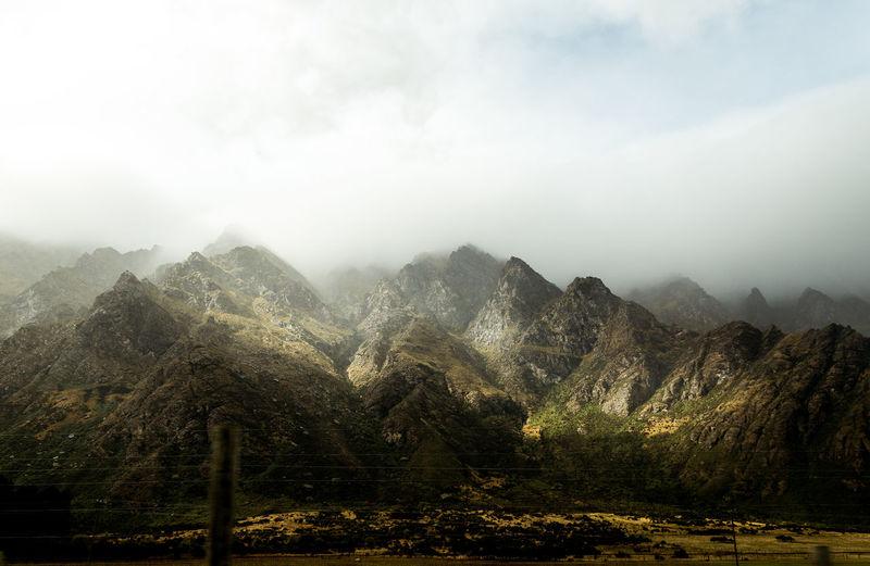 Mountain Beauty In Nature Scenics - Nature Landscape Cloud - Sky Environment Mountain Range Fog Mountain Peak Outdoors Land Sunrays Sunlight