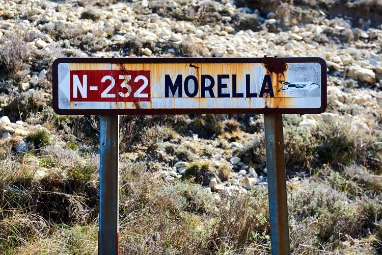 Old road sign of Morrela village, province of Castellon, Valencian Community. Spain Aim Day Direction Directional Sign Europe Guide Information Sign Landmark Location Maestrazgo Morella Name Nobody Non Urban Object Old Town Outdoors Pointer Road Sign SPAIN Text Tourists Attraction Town Travel Destinations Village