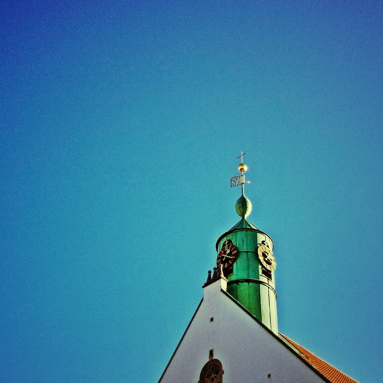 High section of church against clear blue sky