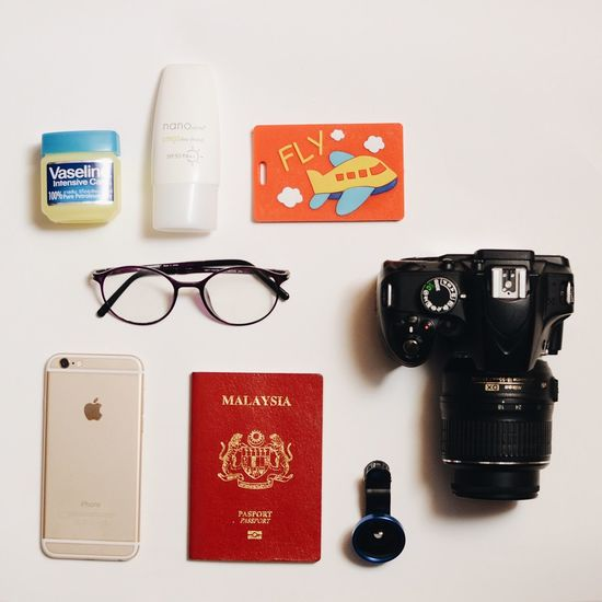 Travel kit with Malaysia Passport. Travel Travel Photography Travelkitflatlay Flatlayphotography Flatlay Travel Kit Indoors  Still Life No People Technology Camera - Photographic Equipment Glasses Table Eyeglasses  Creativity Photography Themes Representation Communication Western Script Directly Above Photographic Equipment Group Of Objects Text Close-up Retro Styled Digital Camera