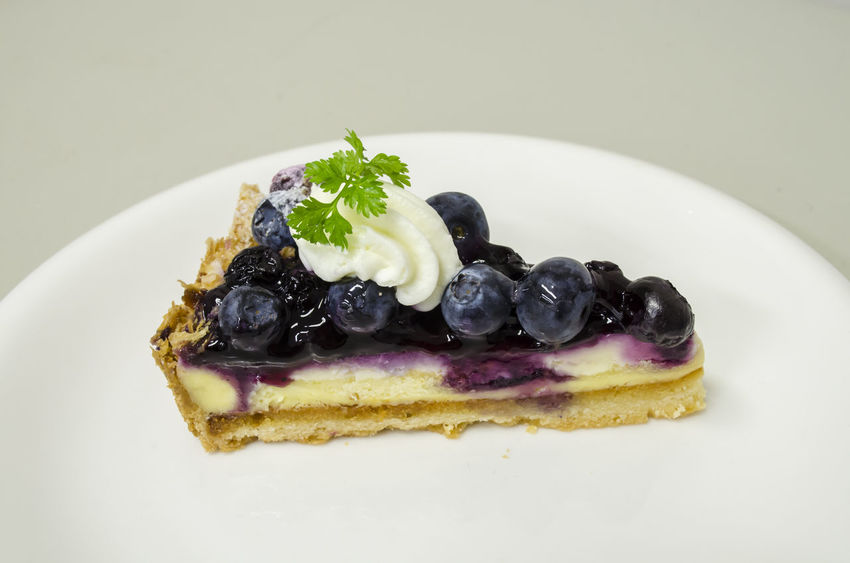 Delicious Blueberry Cheese Pie Blueberry Blueberry Cheesecake Blueberry Pie Blueberrycheesecake Close-up Dessert Food Food And Drink Freshness Fruit Indoors  Indulgence No People Plate Ready-to-eat Serving Size Sweet Food Temptation