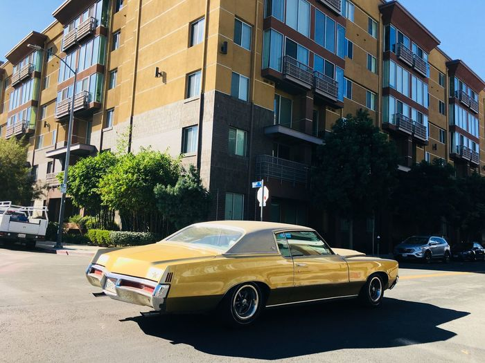Arts District Vintage Throwback Old School Classic Car Car Architecture Transportation Building Exterior Built Structure Mode Of Transport Land Vehicle Day Tree Stationary No People Outdoors Yellow Sky City