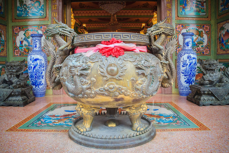 Beautiful dragon sculpture on incense pot burner in the public Chinese temple. Dragon Incense Burn To Worship The Buddha And The Sacred. Incense Burner To Worship Holy Things And Buddha. Dragon Pot Incense Burner Incense Burner. Incense Burners Incense Pot Incense Smoke Incense Stick Incense Sticks