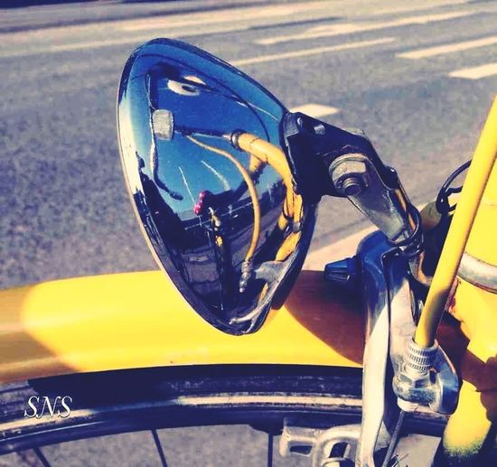mda Transportation Mode Of Transportation Land Vehicle Road Motorcycle Day Reflection No People Close-up Nature Car Sunlight Street Outdoors Motor Vehicle Yellow Focus On Foreground Helmet High Angle View Side-view Mirror