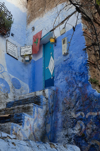 The unique and plentiful selection of door architecture in the blue city of Chefchaouen, Morocco Architecture Door Chefchaouen Chefchaouen Medina Blue City Blue Building Blue Wall Wall Texture Wood - Material Concrete Walkway Gate Stairs