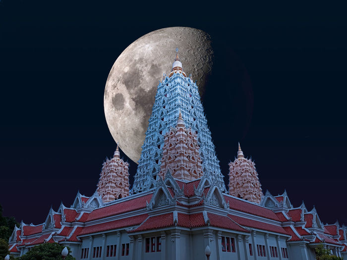 Low angle view of traditional building against sky at night