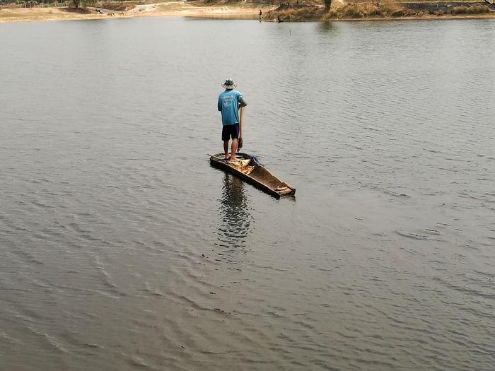 fishing Day Outdoors One Person Working Full Length Men Water Occupation Oar Standing Fisherman Mature Men Farmer